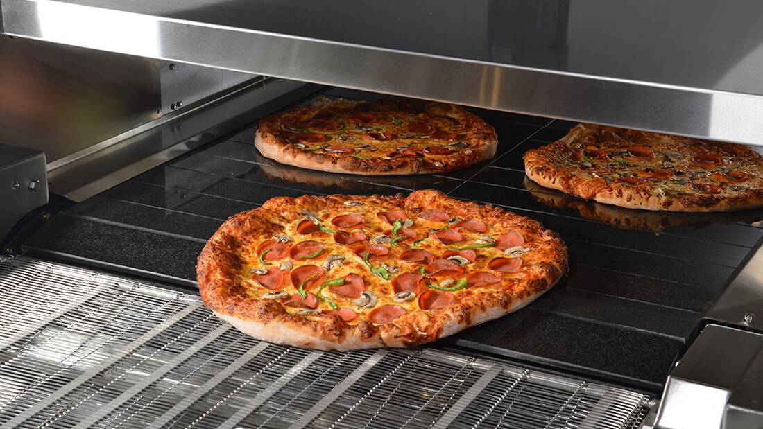 3 pizzas cooked in the Hot Rocks oven with great heat retention