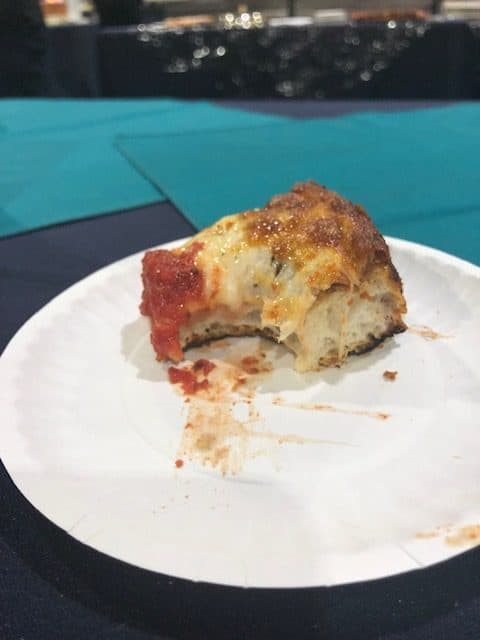 Delicious slice of a deep-dish-pizza cooked in a Hot Rocks oven