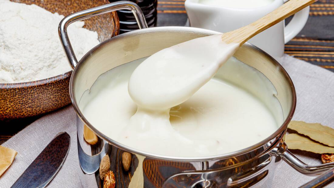 Bechamel pizza sauce in a pan and ingredients